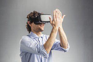 Young man playing in virtual reality