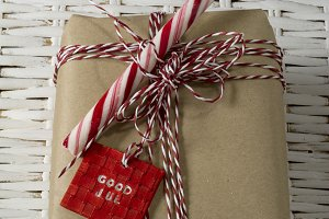 gift box, tied with red and white co