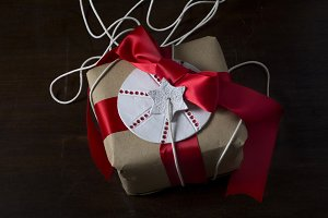 Gift rustic, with red ribbon and sta