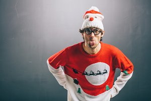 Moody man in funny christmas clothes