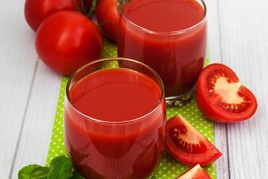 Glasses with tomato juice and fresh