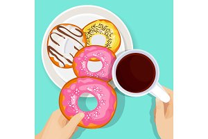 Delicious donuts in glaze with cup of hot coffee