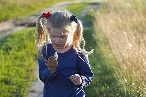 A little girl sees a butterfly