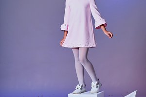 Designer collection. Origami and minimalism. Fashion children. Little girl in beautiful pink dress.