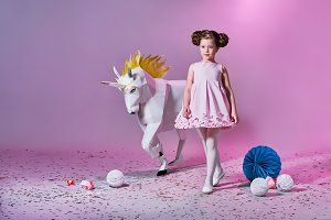 Origami and minimalism. Fashion children. Designer collection. White big unicorn origami made of paper.