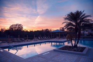 Apartments pool with sunset