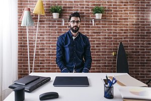 Stylish man sitting in creative work