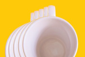 Cups on yellow background