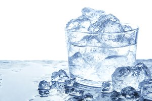 Water with ice cubes in glass