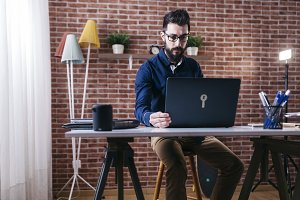 Man working on laptop in stylish off