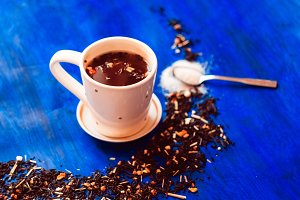 a cup of hot tea. Dried tea leaves i