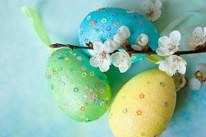 Painted easter eggs and branches of