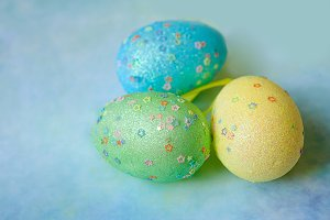 Three colorful handmade easter eggs
