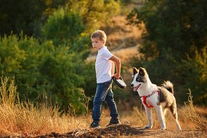 A boy is walking with a dog