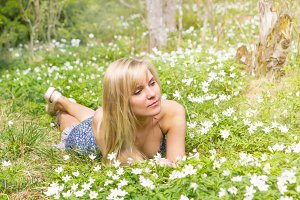 blond woman on spring flower meadow