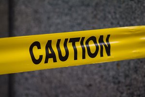Police caution sign tape in city