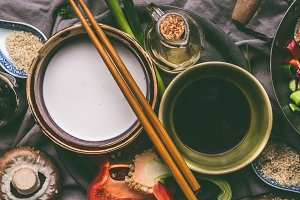 Coconut milk ans soy sauce in bowls