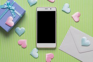 Smartphone, hearts and pastel gift b