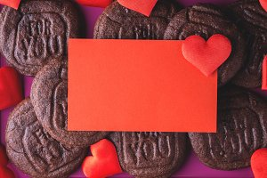 Red blank card, hearts and cookies