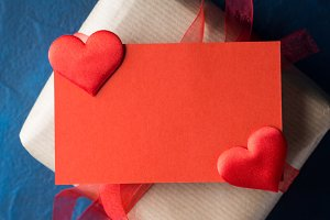 Red blank card and gift with ribbon