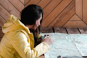 Female studying a map in a lodge