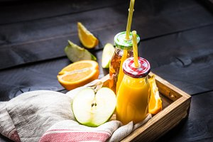 Organic fruit juice in rustic box