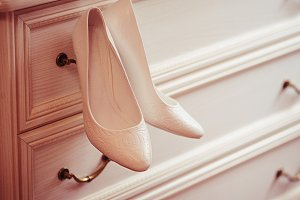 wedding concept. bride's shoes and v