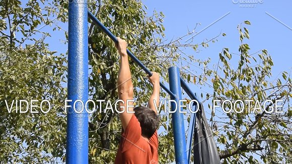 Man Pulls Himself Up On The Bar Playing Sports In The Fresh Air Homemade Horizontal Bar In The Backyard