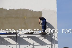 Plasterers Builders plastered wall in a commercial building. Wor