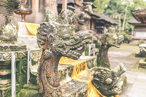 Hindu stone statue in the balinese temple. Tropical island of Bali, Indonesia.
