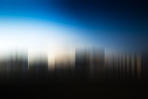 Blurred skyscrapers in daylight background