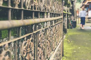 VIntage Rusty Fence in the balinese temple, tropical island of Bali, Indonesia. Hindu temple. Ancient fence.