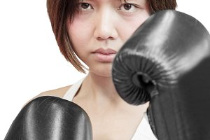 isolated asian female boxer