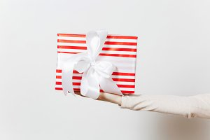 Female hand holding red present box