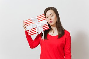 Sad upset woman holding red striped
