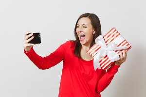 Woman doing selfie on mobile phone w