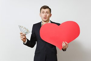 Dissatisfied man with big red heart,