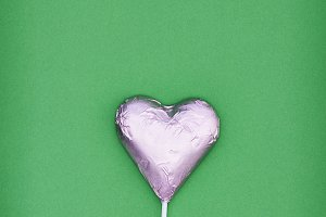 Pink heart chocolate shape . minimal