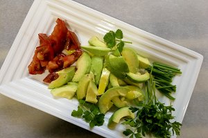 Avocado salade on white tray