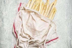 White asparagus under wet towel