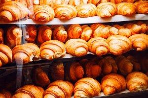 croissants in the shop window. bakin