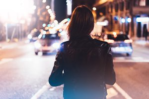 Girl in the city on a night street
