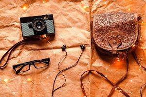 handbag, headphones, camera, glasses