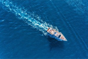 Yacht at the sea. Aerial view of luxury floating ship