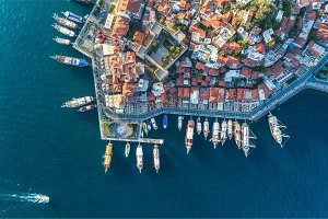 Aerial view of boats, yahts, floating ship and architecture
