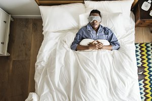 Sleeping on bed with eye mask