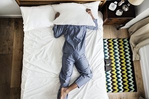 Man on bed insomnia and noise