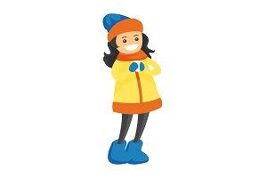 Caucasian white girl holding a little snowball.