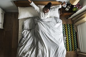 African American woman on bed