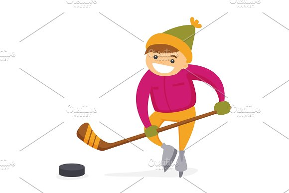 Caucasian Boy Playing Hockey On Outdoor Rink